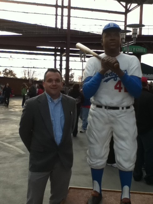 Sculptor Brian Birrer stands next to his wooden statue of Jackie Robinson  that was recently on display at Citizen's Bank Park in Philadelphia