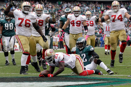 Niners running back Frank Gore scores the winning touchdown as the 49ers rallied from a 20-point deficit to beat the Eagles.