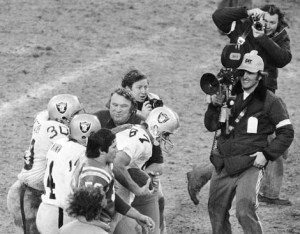 Raiders wide receiver Dave Casper get congrats from teammates and head coach John Madde n after catching winning pass to beat the Baltimore Colts in overtime in the 1977 AFC Divisional Playoffs.