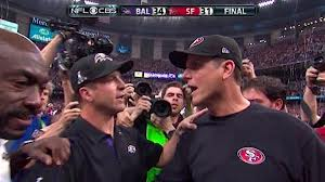 Baltimore Ravens head coach John Harbaugh (left) shakes hands with his brother Jim Harbaugh, the 49ers head coach after the end of Super Bowl XLVII.