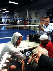 Bernard Hopkins (left) gets his hand taped by his trainer Nazim Richardson during a workout session at Joe Hand's Gym in North Philadelphia. Hopkins will take on Tavoris Cloud for the IBF Light Heavyweight crown on March 9 in Brooklyn, N.Y.  Photo by Chris Murray.