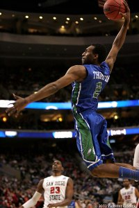 Florida Gulf Coast guard Bernard Thompson is about unleash a vicious dunk during a 17-0 run in the Eagles win over San Diego State in the Third Round of the NCAA Tournament. Photo by Webster Riddick
