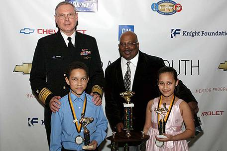 Siblings Davion and Jasmine Ferrell proudly show off their awards at the Urban Youth Racing School 15th anniversary Gala dinner held at the National Constitution  Center last weekend.  Photo by Webster Riddick.