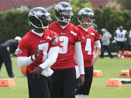 (From left to right): Michael Vick, Dennis Dixon and G.J. Kinne take turns throwing the ball during the first day of OTAs. Photo courtesy of PhiladelphiaEagles.com.
