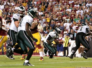 Michael Vick's hard-charging style has often landed him on the injury list. Photo by Webster Riddick.