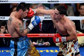 Danny Garcia (right) lobs a right the chin of Lucas Matthysee in their WBA/WBC super lightweight title fight in Las Vegas last month.