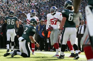 Eagles quarterback Matt Barkley (left) looks up at Giants linebacker Jacquian Williams, who recovered his fumble late in the second quarter. Photo by Webster Riddick.