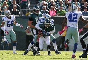 Nick Foles gets sacked by Cowboys defensive end Kyle Wilber in the Birds loss to Dallas.  Photo by Webster Riddick.