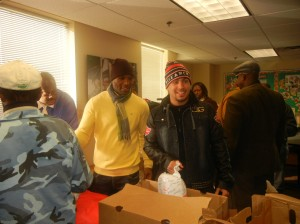Hopkins and Garcia passing out holiday turkeys to low-income residents of West Philly. Photo by Chris Murray.