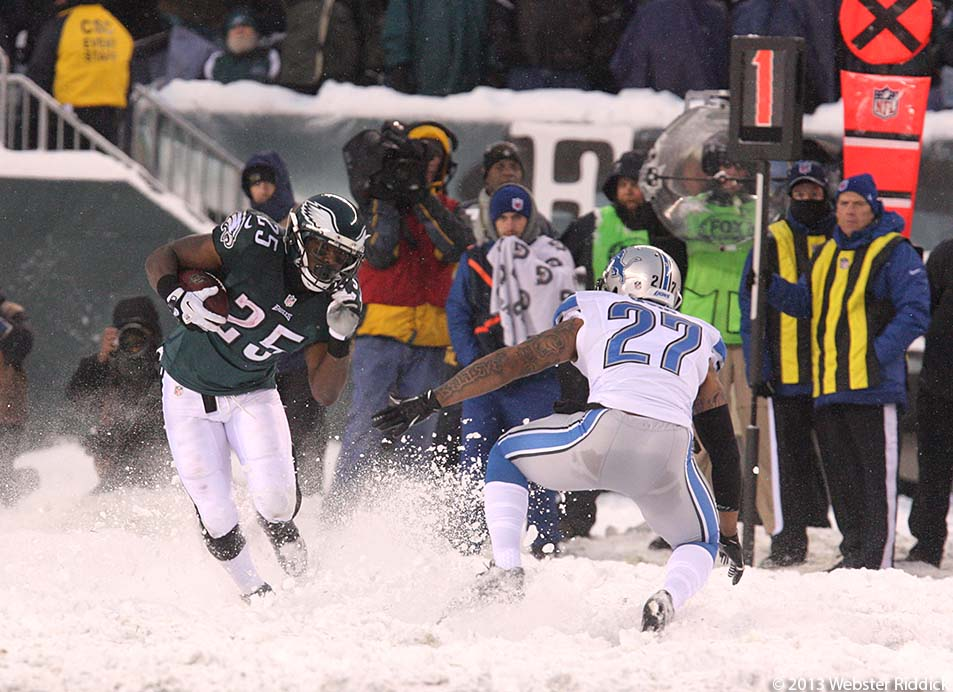 Eagles running back Shady McCoy puts a move on Detroit Lions strong safety Glover Quin en route to a 41-yard touchdown run. Photo by Webster Riddick.