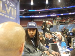 Richard Sherman addresses reports during Super Bowl XLVIII Media Day at the Prudential Center in Newark, N.J. Photo by Chris Murray