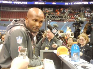 Broncos cornerback Champ Bailey fields questions from reporters during Super Bowl XLVIII Media Day. Photo by Chris Murray.