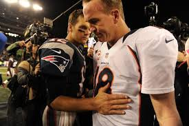 Tom Brady and Peyton Manning greet each other after the Patriots 34-31 win on Nov. 24.  Photo by the DenverPost.com.
