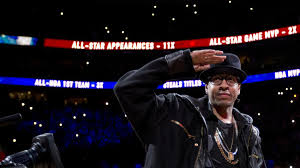 Allen Iverson gives a salute to Sixers fans at the Wells Fargo Center as the team retired his jersey during halftime of the 76ers game versus the Washington Wizards.  Photo by Yahoo.com.