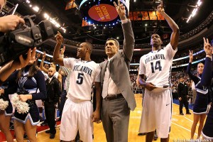 (from left to right) Villanova senior guard Tony Chennault, head coach Jay Wright and freshman forward Darryl  Reynolds salute the crowd after Saturday's win over Georgetown in the regular-season finale. Photo by Webster  Riddick.
