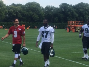 Eagles safety Malcolm Jenkins walking off the field with Eagles backup quarterback Mark Sanchez. Jenkins is fast becoming the leader of the Eagles secondary. Photo by Chris Murray.