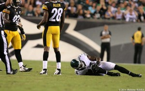 Eagles wide receiver Jeremy Maclin grabs his right knee in pain after his foot apparently got stuck in the turf. He was not seriously injured. Photo by Webster Riddick.