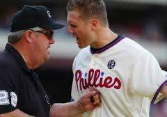 Umpire Joe West and Phillies closer Jonathan Papelbon engage in a heated argument after the Phils pitcher is ejected from the game.