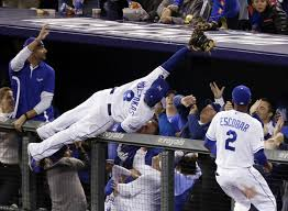 Kansas City Royals third baseman Mike Moustakas makes an incredible catch in the stands in Game 3 of the 2014 American League Championship Series.