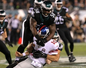 Eagles outside linebacker Trent Cole collars Eli Manning. It was one of eight sacks by the Birds against the Giants. Photo by Webster Riddick