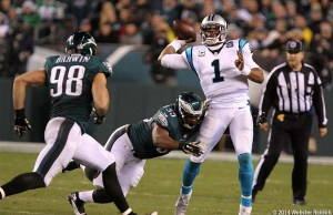 Connor Barwin (98) and Brandon Graham converge on Carolina quarterback Cam Newton.  The Eagles had eight sacks. Photo by Webster Riddick.