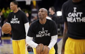"Los Angeles Lakers guard Kobe Bryant dons his ""I can't Breathe"" T-shirt during his team's around on Monday."