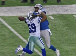 Cowboys linebacker Anthony Hitchens collides with Lions tight end Brandon Pettigrew on a controversial reversal of a pass interference call.