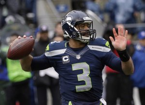 Russell Wilson launching his game-winning overtime touchdown pass to Jermaine Kearse to send the Seattle Seahawks to the Super Bowl. Photo courtesy of the StarTribune.com