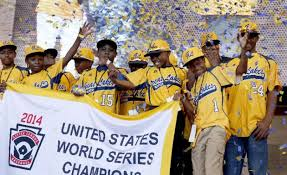 In what was a happier moment, the kids from Chicago's Jackie Robinson West Little League squad celebrate winning the U.S. Championship in the Little League World Series. The title was recently stripped from Jackie Robinson West because of rules violations.  Photo by Huffington Post.