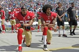 Colin Kaepernick and teammate Eric Reid (left) take a kneel during the national anthem to protest the unarmed killings of Black people by the police. As of Aug. 10, Kaepernick remains unsigned.